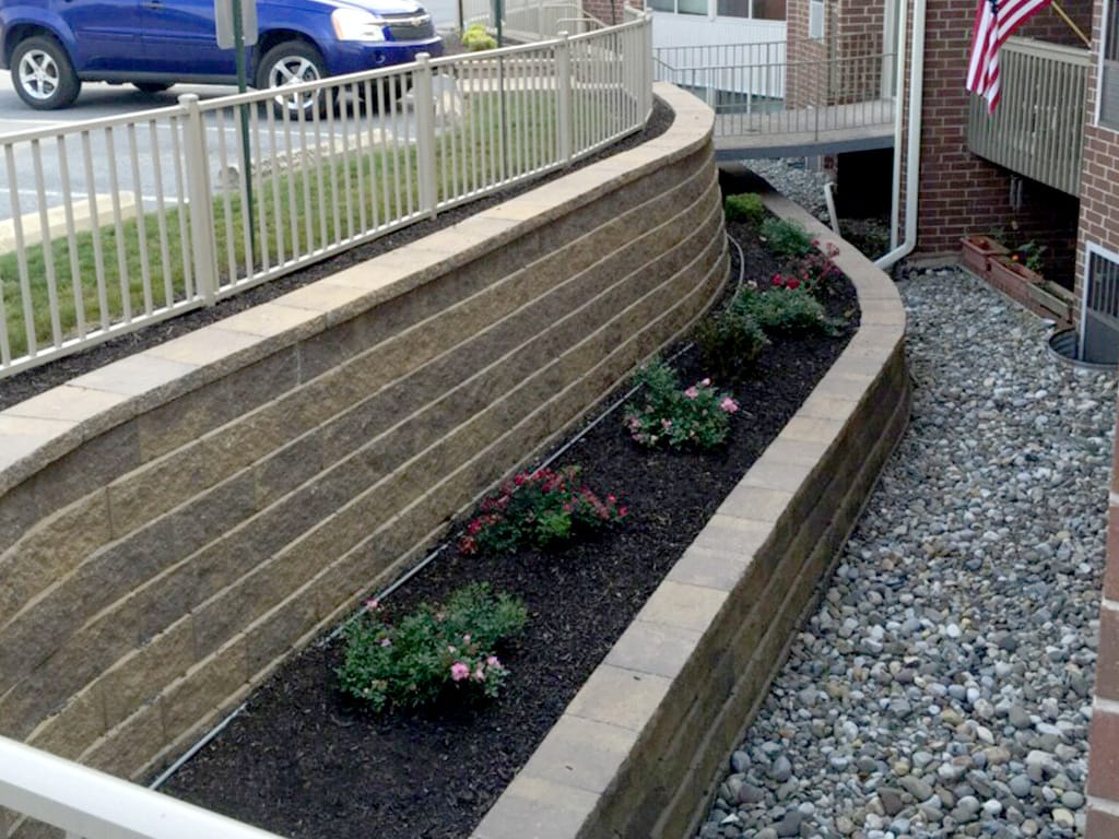 Apartment complex two tiered retaining wall close up