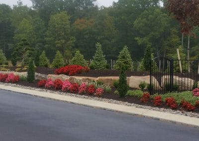 Plant bed with boulders and fence