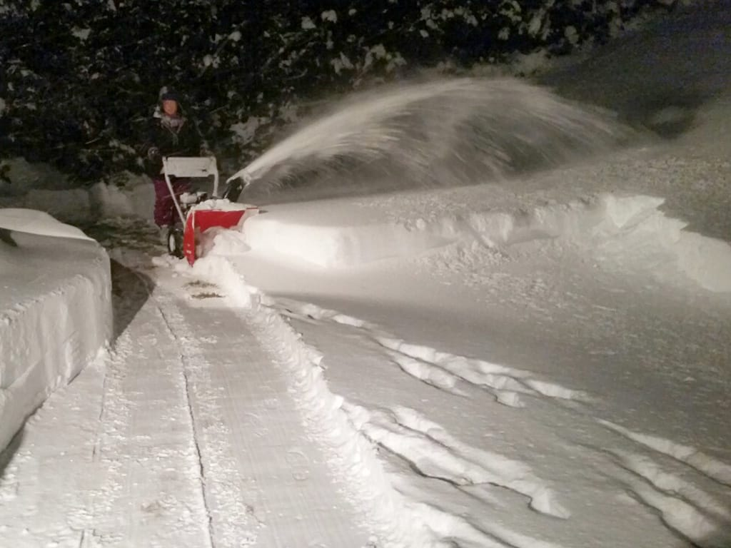 Snow blowing walkway