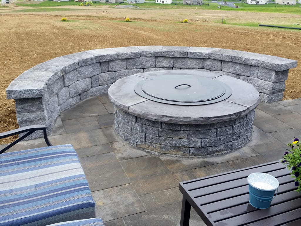 York mountain ridge patio with Stoneledge granite fire pit & seat wall