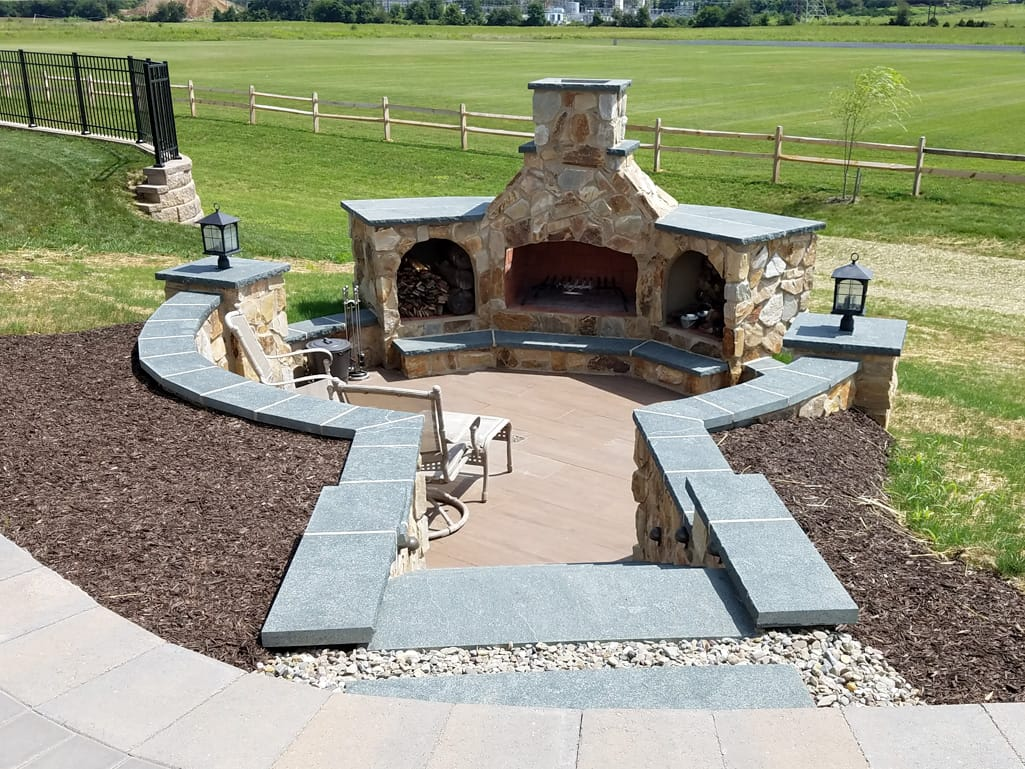 Entrance to outdoor fireplace from upper patio