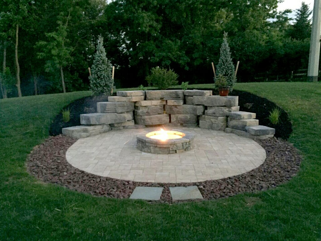 Dusk Image of Lafitt paver patio, Belvedere firepit, & Outcropping backdrop wall