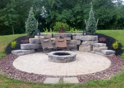 Lafitt paver patio, Belvedere firepit, & Outcropping backdrop wall