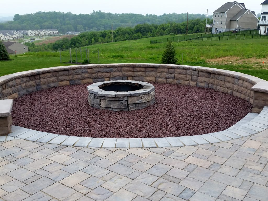 Ground level view of Belair sitting wall, Lafitt pavers, & Belvedere firepit