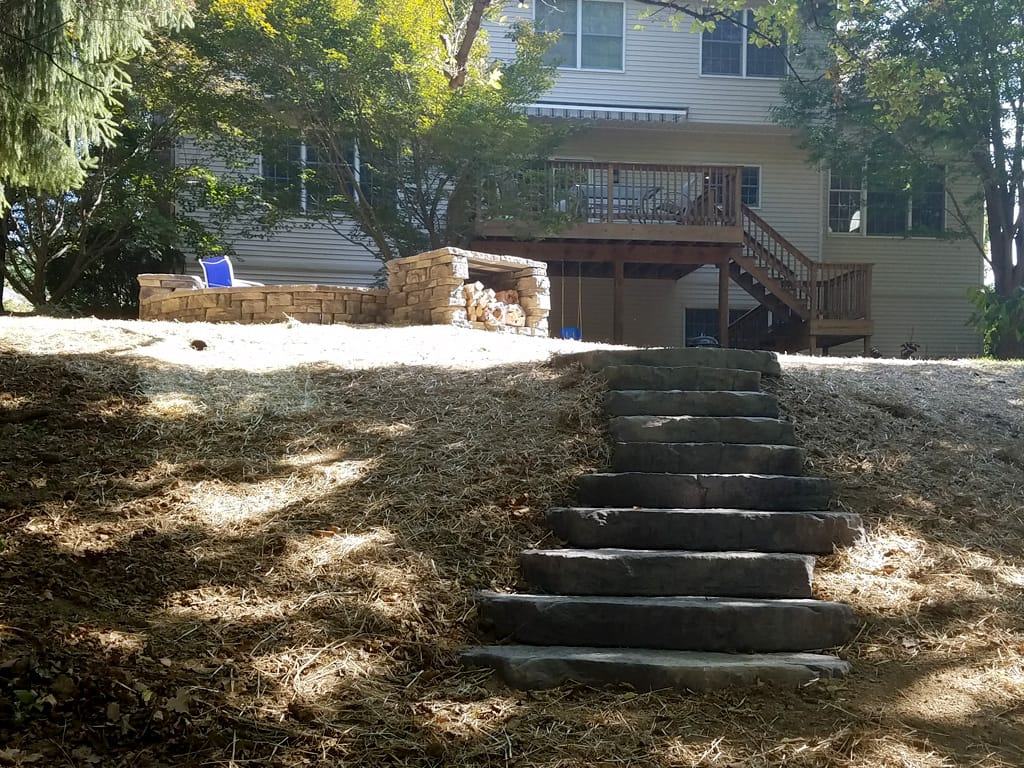 Irregular steps leading up to fire pit and patio