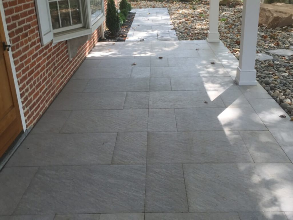Close up of front porch Quartziti stone finish tile in waterfall