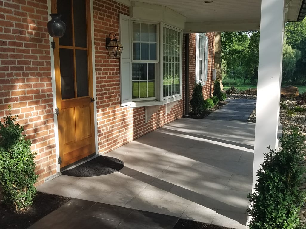 Front porch in Quartziti stone finish tile patio & landscape