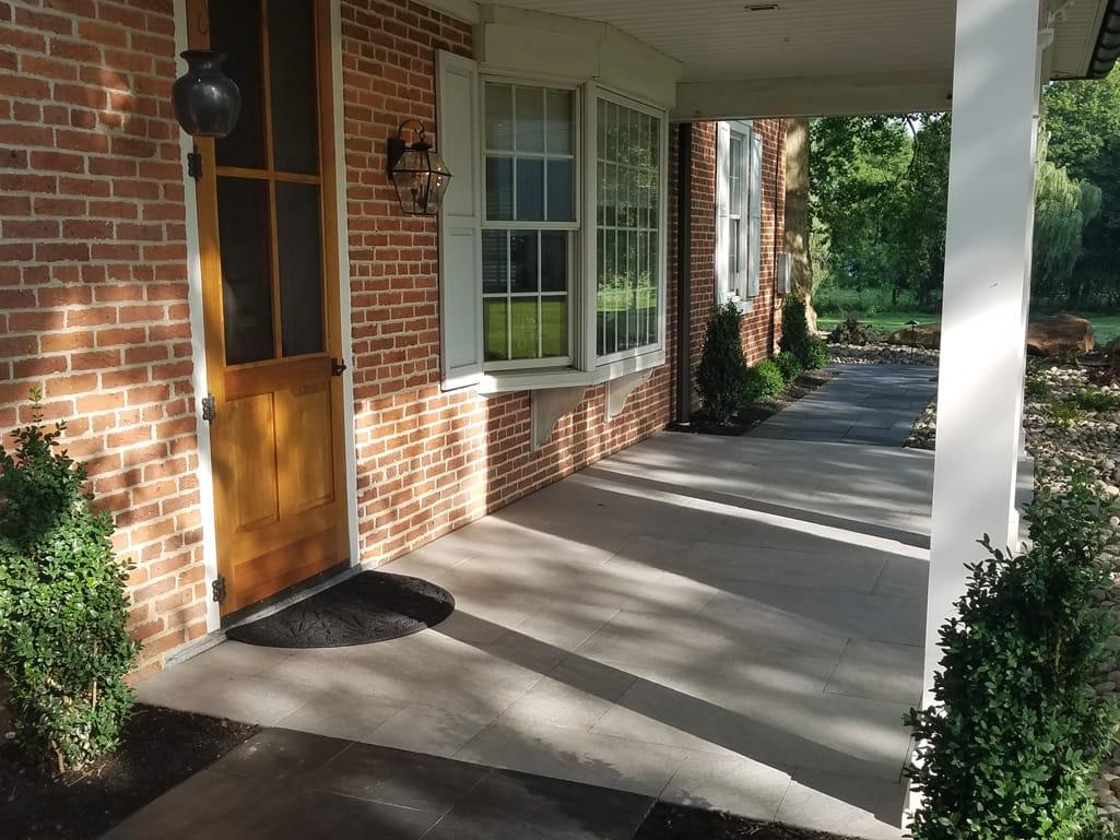 Front porch in Quartziti stone finish tile patio & landscape